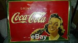 1930's Coca-Cola tin sign with girl holding coke bottle