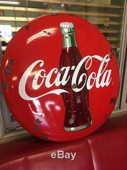 1950s 24 INCH PORCELAIN COCA COLA BUTTON WITH BOTTLE