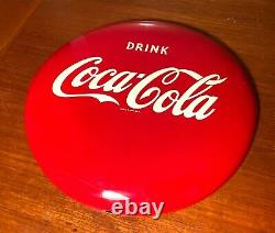 Coca Cola 1950s or 1980s 12 Inch Metal Button Sign