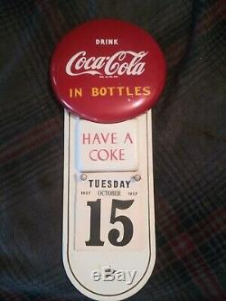 Coca cola calendar sign button