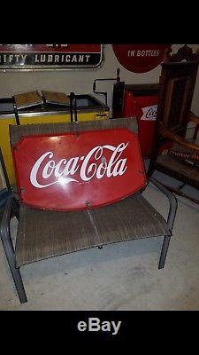 Coca cola shield sign