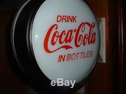 Lighted Coca Cola flange sign