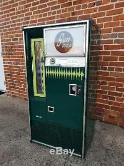 Sundrop sign soda bottle machine golden girl coca cola Cheerwine coke pepsi 7up